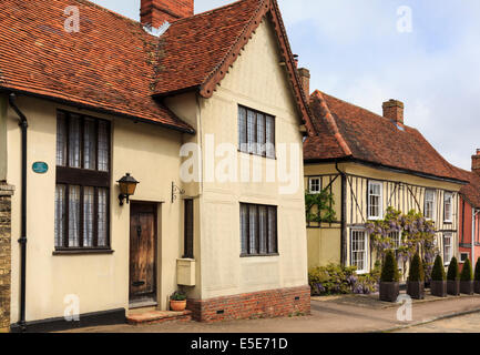 Street scene with quaint old detached houses in village of Lavenham, Suffolk, England, UK, Britain - Stock Photo
