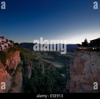 Magnificent view from the New Bridge of Ronda in Andalusia, Spain at evening - Stock Photo