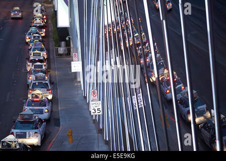 Taxi cabs reflects in buildings on The Strip Las Vegas Paradise, Nevada USA - Stock Photo