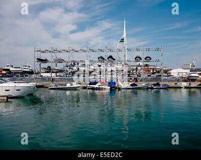 Multi storey boat rack holding Rigid inflatable boats at Camber Docks in Old Portsmouth. - Stock Photo