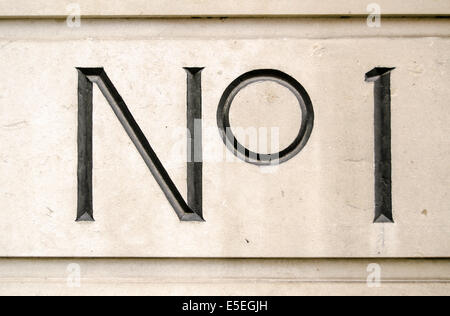 Sign for number one on the outside of an office block in central London. - Stock Photo