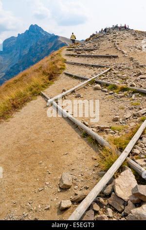 Touristic path in Tatra mountains that leads from Kasprowy Wierch to Czerwone Wierchy - Stock Photo