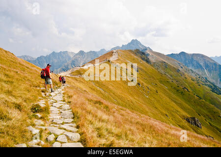 KASPROWY WIERCH, POLAND - SEPTEMBER 3: A man equipped for hiking standing on the walking path in Tatra mountains - Stock Photo