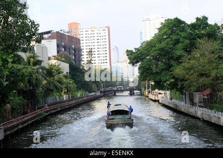 The express public boat on Khlong Saen Saeb, one of the main transport canals in central Bangkok, Thailand - Stock Photo
