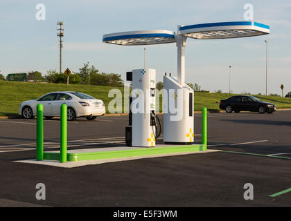Electric car charging station and parking lot in USA installed by NRG eVGO to recharge electric cars - Stock Photo