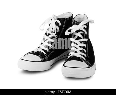 Black high top sneakers on a white background - Stock Photo