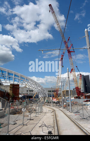Tramlines leading to the construction of the new extension to Victoria Railway Station in Manchester. - Stock Photo