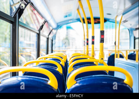 Empty seats on a London Bus and bus stop button for getting off. - Stock Photo