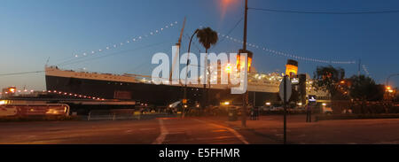 The stately RMS Queen Mary at dusk - Stock Photo