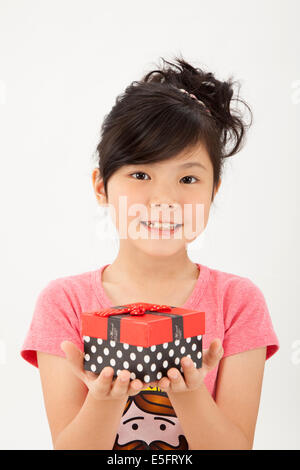 Cute asian chinese little girl holding gift box - Stock Photo