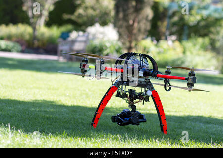 A drone or Unmanned Aircraft waiting for takeoff - Stock Photo