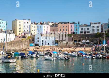 Tenby harbour full of boats on a sunny afternoon, the picturesque seaside town in Pembrokeshire, Wales - Stock Photo