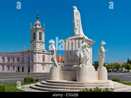 statue of queen D. Maria I in the Largo do Palácio de Queluz with the Pousada behind - Stock Photo