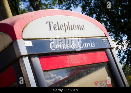 BT telephone box in England - Stock Photo