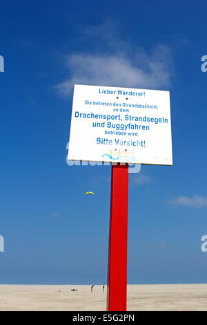 Borkum, Germany: July 29, 2014 - warning sign on the beach - Stock Photo