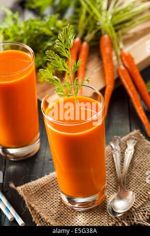 Organic Raw Carrot Juice with Fresh Fruit - Stock Photo