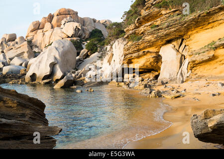 Capo Testa beach and rock formations at sunset in Santa Teresa di Gallura, Sardinia, Italy - Stock Photo
