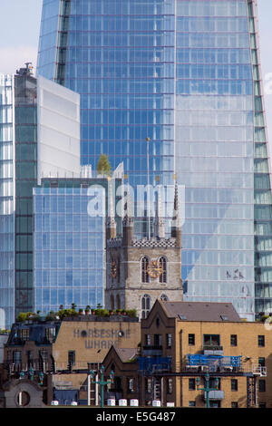 Southwark Cathedral, the Horseshoe Wharf building and the edifice of the Shard behind in Borough, Southwark, London - Stock Photo