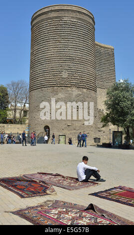 Carpet stall in front of the Maiden Tower, Old Town, Baku, Azerbaijan - Stock Photo