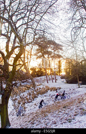 Children playing in Crystal Palace park, Penge, London in winter - Stock Photo