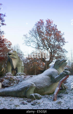 An Iguandon by 19th Century sculptor Benjamin Waterhouse Hawkins, Dinosaur Court, Crystal Palace park, in snow. - Stock Photo
