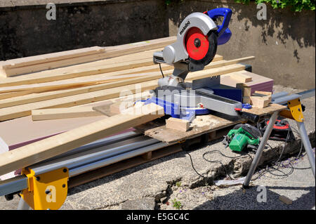 Sliding compound mitre chop saw on portable saw table for construction work - Stock Photo