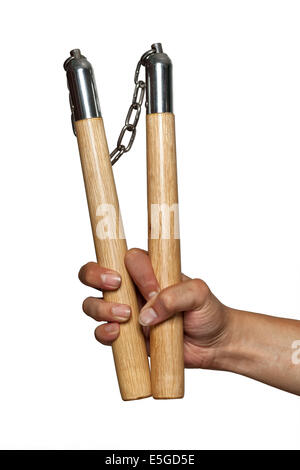 Nunchucks in man hand on white background - Stock Photo