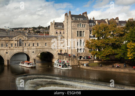 UK, England, Wiltshire, Bath, excursion boats on River Avon passing under Pulteney Bridge - Stock Photo