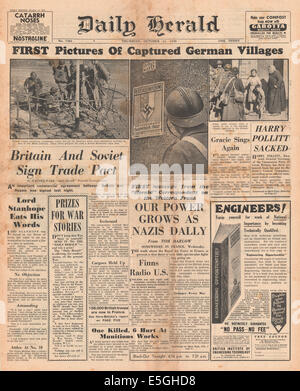 1939 Daily Herald front page showing French forces in captured German villages and Britain and Soviet Russia sign - Stock Photo