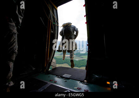 A U.S. Army paratrooper with the 2nd Battalion, 505th Parachute Infantry Regiment, 3rd Brigade Combat Team, 82nd - Stock Photo