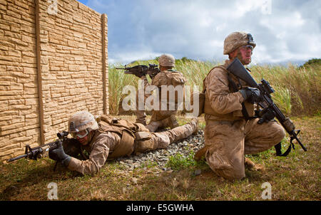 U.S. Marines assigned to India Company, 3rd Battalion, 3rd Marine Regiment, provide security outside of a compound - Stock Photo
