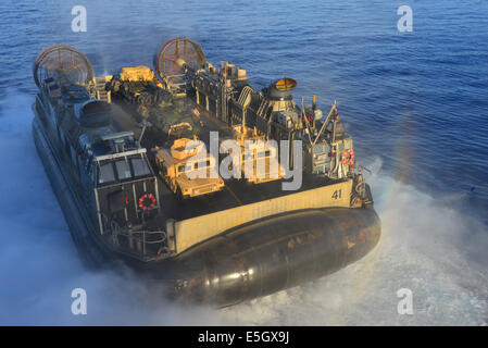 A U.S. Navy landing craft, air cushion attached to Assault Craft Unit 4 leaves the well deck of the amphibious assault - Stock Photo