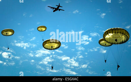 Paratroopers jump onto the Iron Mike drop zone in Sainte-M?re-?glise, France, June 8, 2014. More than 600 U.S., - Stock Photo