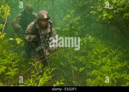 U.S. Army paratroopers assigned to Charlie Company, 2nd Battalion, 503rd Infantry Regiment, 173rd Airborne Brigade - Stock Photo