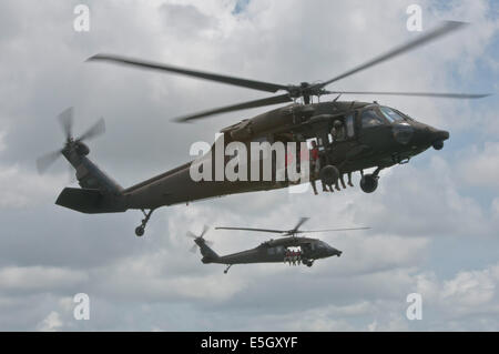 U.S. Army UH-60 Black Hawk helicopters assigned to the 5th Battalion, 159th Aviation Regiment transport Soldiers with the 365th