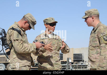U.S. Army Spc. Henry Coredero, center, an explosive ordnance disposal (EOD) specialist with the 787th EOD Company, - Stock Photo