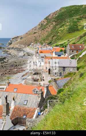 View of small village of Crovie on coast of Aberdeenshire in Scotland - Stock Photo