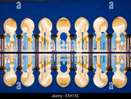 Night view of reflection of Sheikh Zayed Grand Mosque in Abu Dhabi United Arab Emirates - Stock Photo