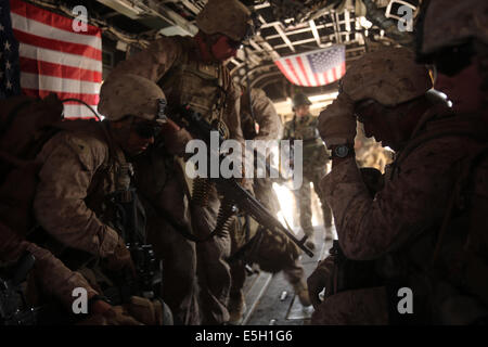 U.S. Marines with Bravo Company, 1st Battalion, 7th Marine Regiment board a CH-53E Super Stallion helicopter during - Stock Photo