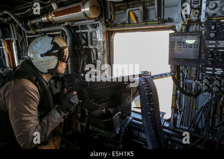 U.S. Marine Corps Cpl. Hershel Lopresto, a crew chief with an aviation combat element with Marine Rotational Force - Stock Photo