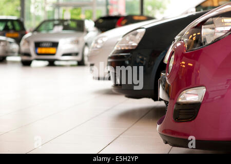 Cars in showroom by used car dealer - Stock Photo