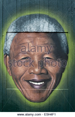 Some Street art representing Nelson Mandela in Stephenson Square in the Northern Quarter area of Manchester city - Stock Photo