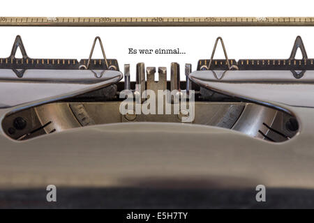 The Words 'Es war einmal' (German Once upon a time) written on a typewriter - Stock Photo