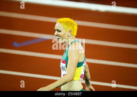 Hampden Park, Glasgow, Scotland, UK. 31st July, 2014.  Day 8 evening athletics session.  Women's 100m hurdles heat - Stock Photo