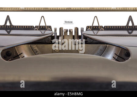 The Word 'Notice' written on a typewriter - Stock Photo