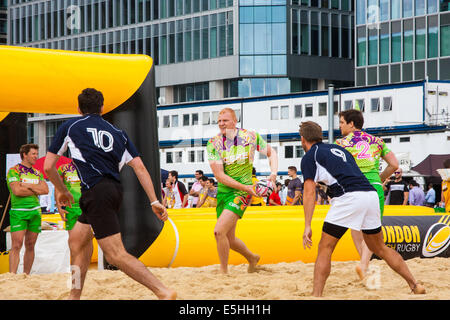 Canary Wharf, London, 1st August, 2014. Teams from various London companies compete for glory in the London Beach - Stock Photo