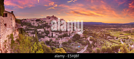 The historic village of Gordes in the Provence, France at sunrise - Stock Photo