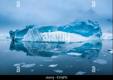 Iceberg in the Antarctic waters, Enterprise Island, Antarctica - Stock Photo