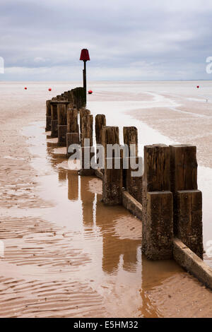 UK, England, Lincolnshire, Cleethorpes, breakwater beside pier on Humber Estuary - Stock Photo