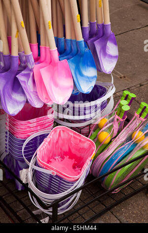 UK, England, Lincolnshire, Cleethorpes, colourful plastic buckets and spades for sale at seafront stall - Stock Photo